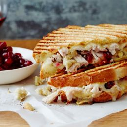 panini next to dish of cranberry sauce
