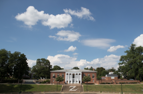Garrett Hall on a sunny day with white fluffy clouds in the sky