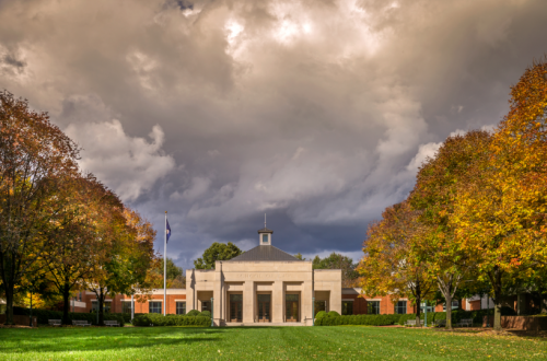Photo of the Law School in early Fall with a stormy sky