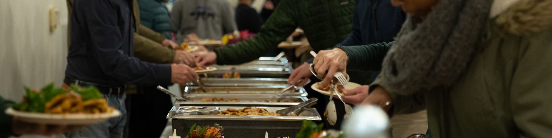Attendees from the 2019 MLK Community Event, Voices for change, getting food at a vegan buffet station